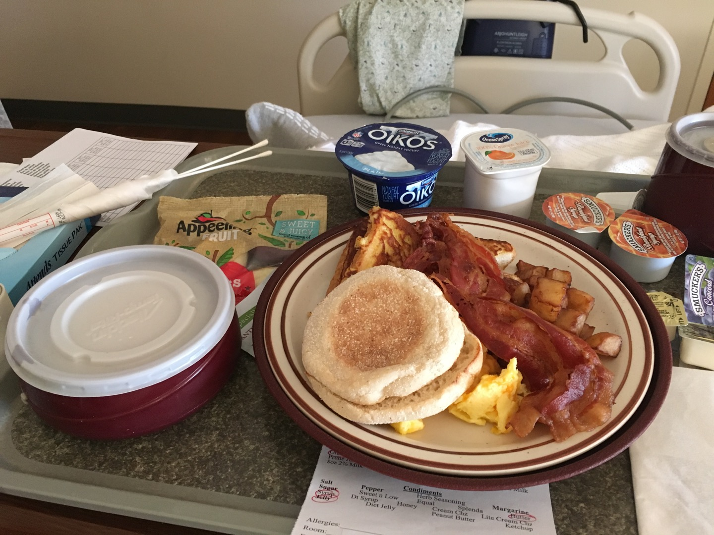Scrambled eggs with cheese, french toast, bacon, english muffin, oatmeal, apple slices, plain greek yogurt. I didn't eat all of this, but just a little bit of each.