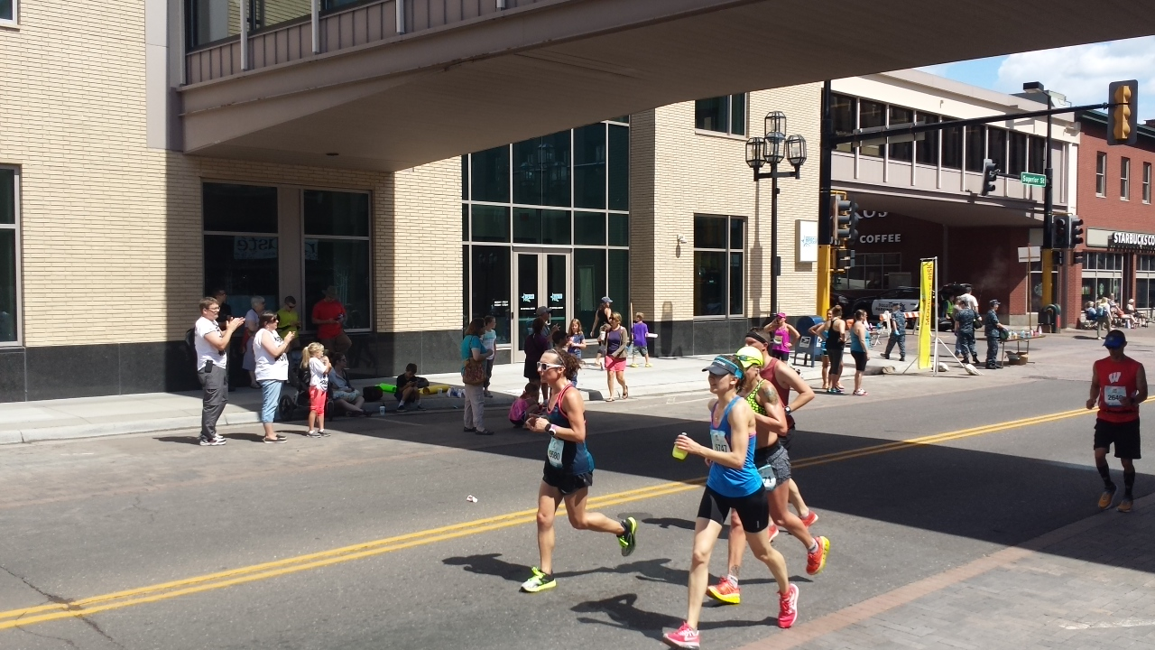 Amelia Gapin running in downtown Duluth during Grandma's Marathon.