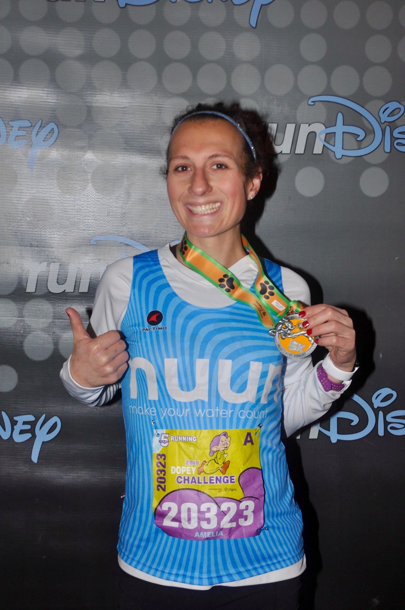 Amelia after the 2018 Disney World 5k holding her medal
